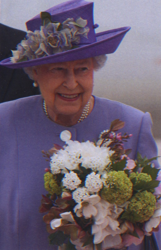 Her Majesty The Queen in Rome on 3April 2014 with flowers from the Villa Wolkonsky Gardens.
